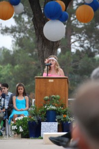 Lucy giving a speech at her graduation