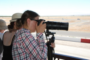 Angela Heine: Race Photographer... whose lens costs more than the cars racing! ;)